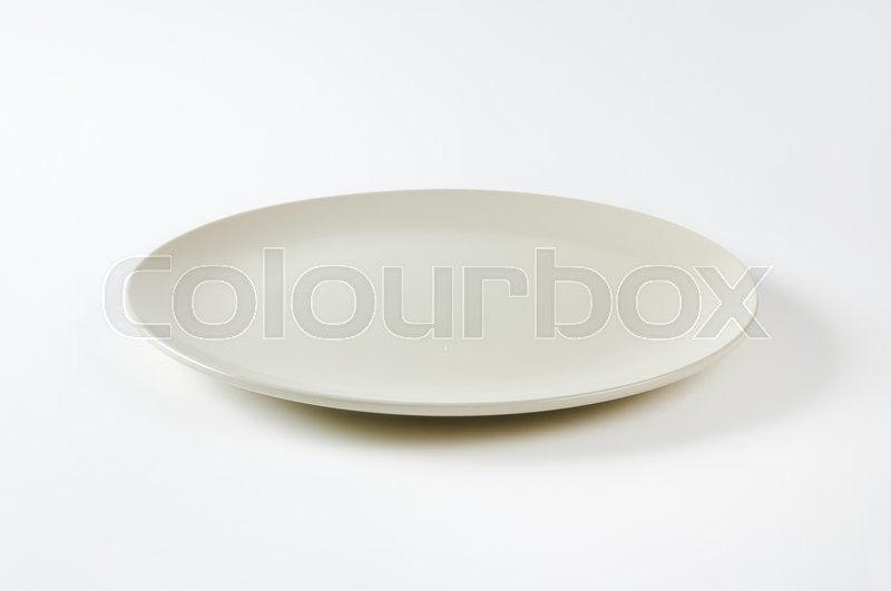 Stock image of 'Coup shaped round bone white ceramic plate'