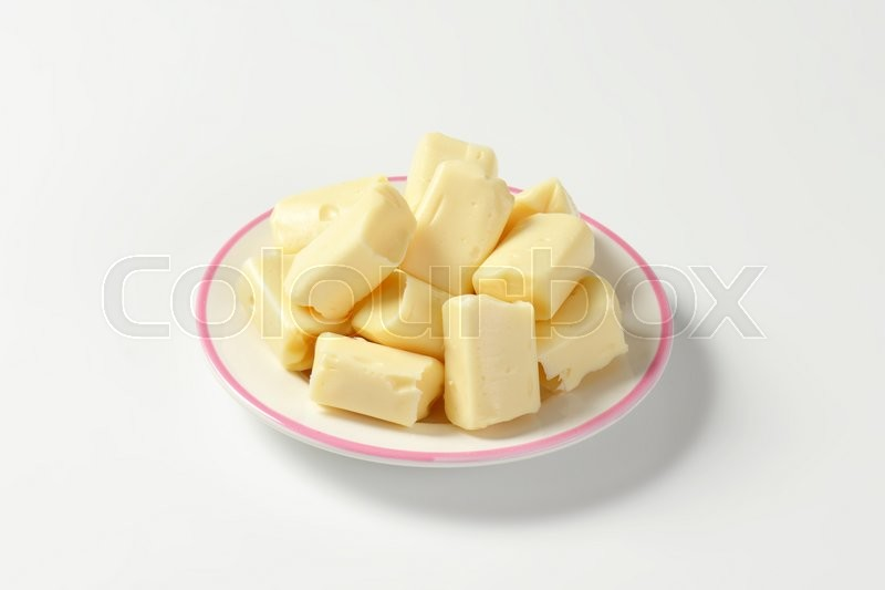 Stock image of 'plate of milk toffee candies on white background'