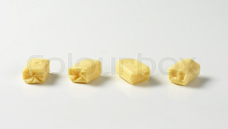 Stock image of 'Four milk chewy candies on white background'