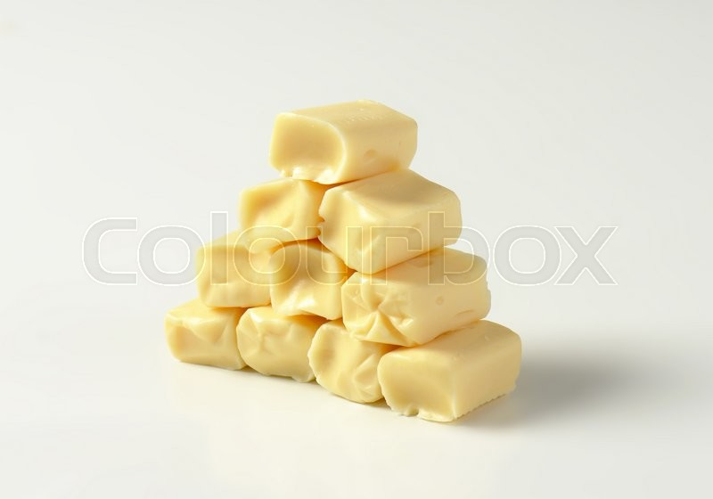 Stock image of 'Stack of caramel-like white chewy candies'
