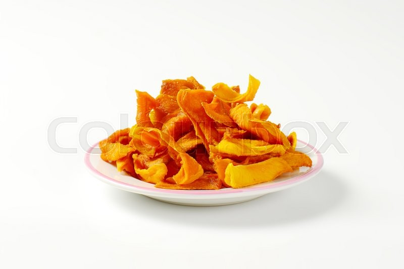 Stock image of 'Plate of dried mango slices'