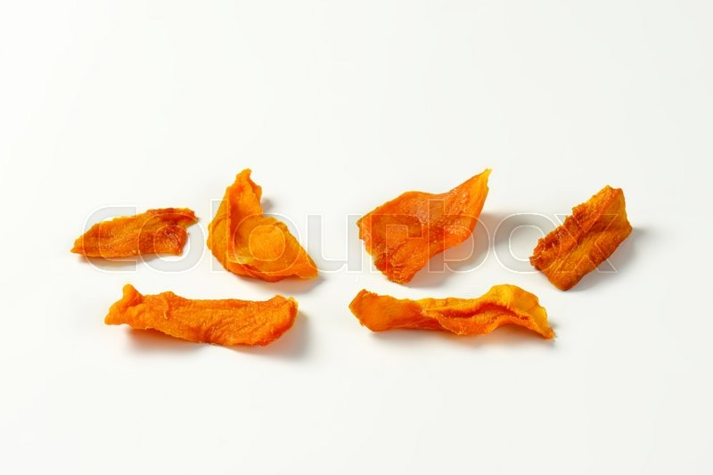 Stock image of 'Dried mango slices on white background'