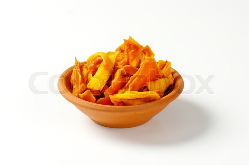 Stock image of 'Bowl of dried mango slices on white background'
