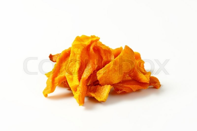 Stock image of 'Heap of dried mango slices on white background'