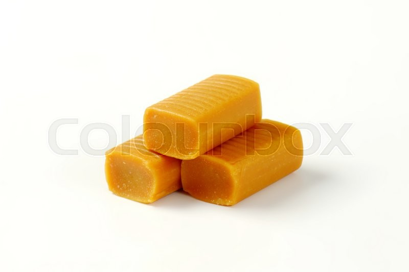 Stock image of 'Chewy toffee candies on white background'