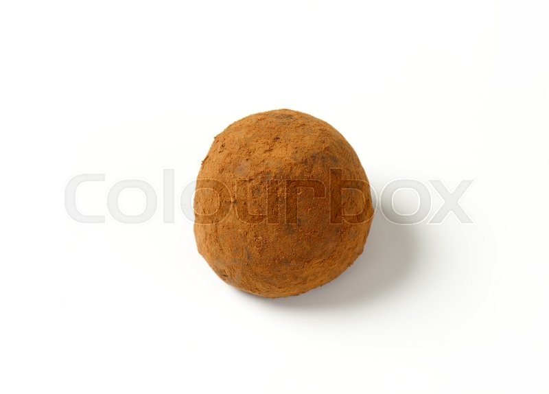 Stock image of 'Chocolate truffle coated in cocoa powder'