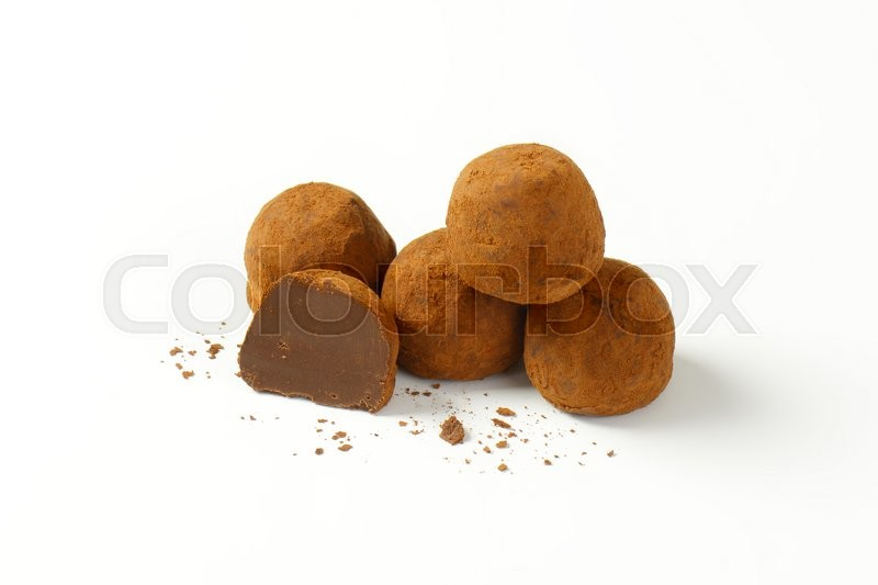 Stock image of 'Chocolate truffles coated in cocoa powder'