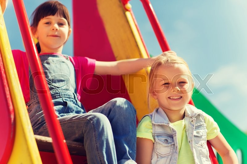 Stock image of 'summer, childhood, leisure, friendship and people concept - happy kids on children playground climbing frame'