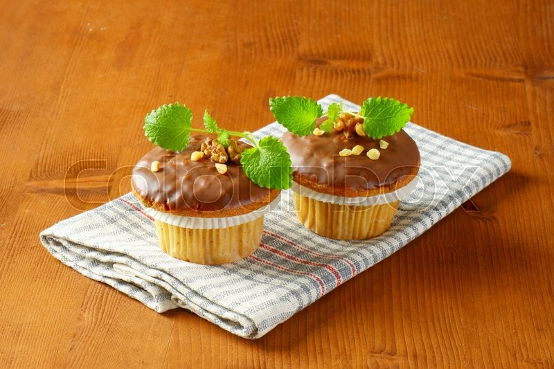 Stock image of 'Nut muffins with chocolate glaze'