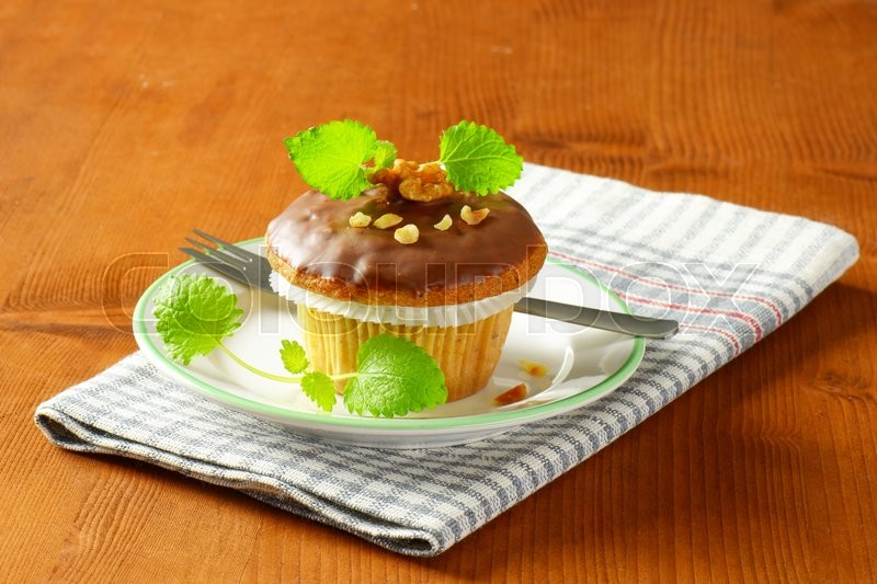 Stock image of 'Nut muffin with chocolate glaze'