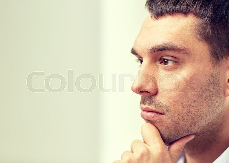 Stock image of 'business, people and work concept - close up of businessman male face'