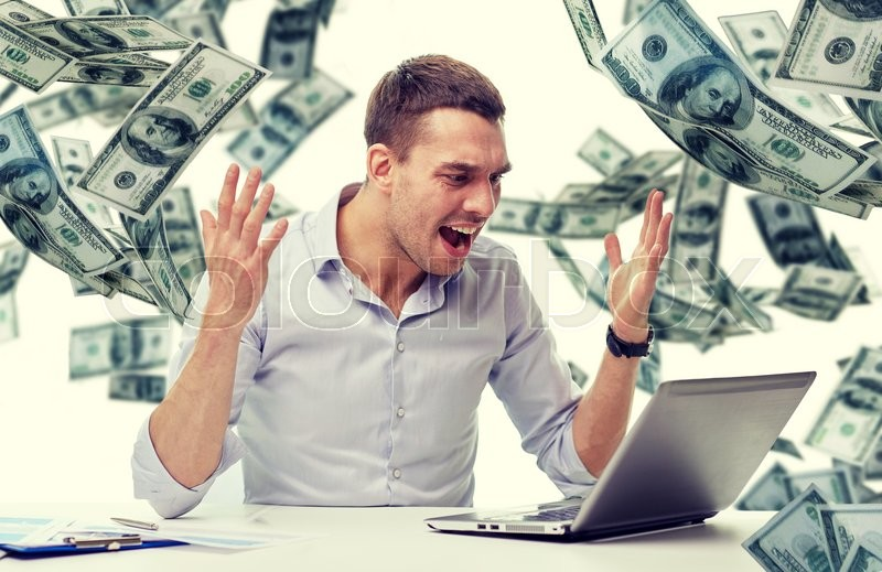 Stock image of 'business, people, stress, fail and technology concept - angry businessman with laptop computer and papers shouting over falling money background'