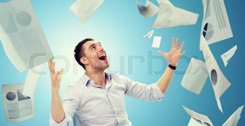 Stock image of 'business, people, success concept - businessman with falling papers over blue background'