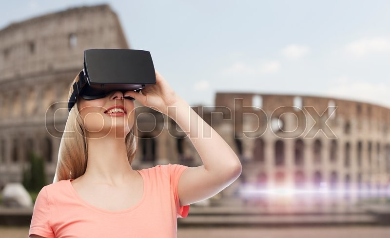 Stock image of 'technology, virtual reality, entertainment, travel and people concept - happy young woman with virtual reality headset or 3d glasses over rome coliseum background'