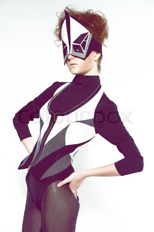 Stock image of 'Brown hair model in futuristic clothes studio shot'