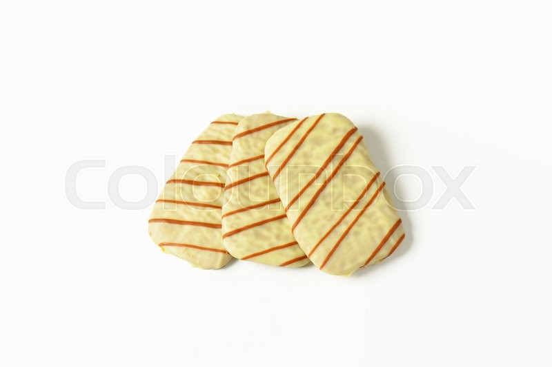 Stock image of 'Thin butter biscuits covered in white chocolate'