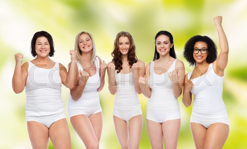 Stock image of 'success, friendship, beauty, body positive and people concept - group of happy plus size women in white underwear celebrating victory over green natural background'