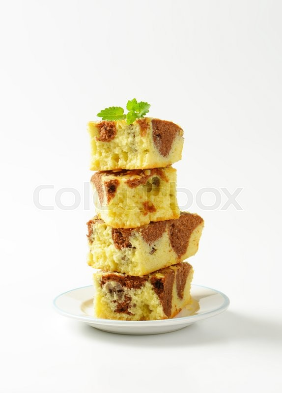 Stock image of 'Stacked pieces of Marbled Madeira Cake'