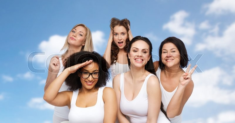 Stock image of 'friendship, beauty, body positive and people concept - group of happy plus size women in white underwear having fun and making faces over blue sky and clouds background'
