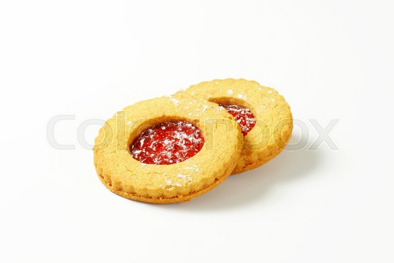 Stock image of 'Shortbread cookies filled with red currant preserve called Linzer Eyes'