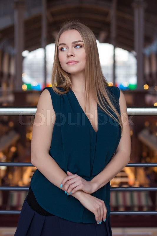 Stock image of 'Attractive business woman in an office building on the work'