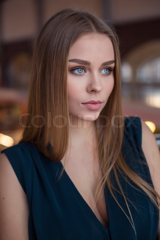 Stock image of 'Beautiful young businesswoman against urban city background.'