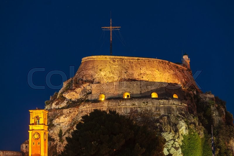Stock image of 'Evening view of illuminated  Old fortress, Kerkyra, Corfu island, Greece'