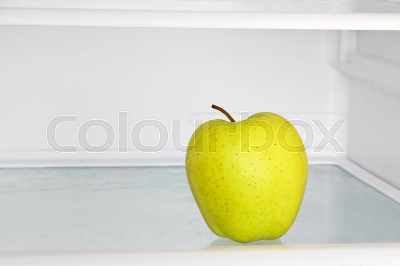 Stock image of 'Lifestyle concept.Yellow apple in domestic refrigerator taken closeup.'