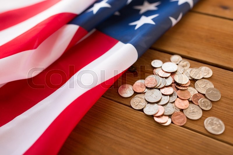 Stock image of 'budget, finance, money, crisis and nationalism concept - close up of american flag and cent coins'