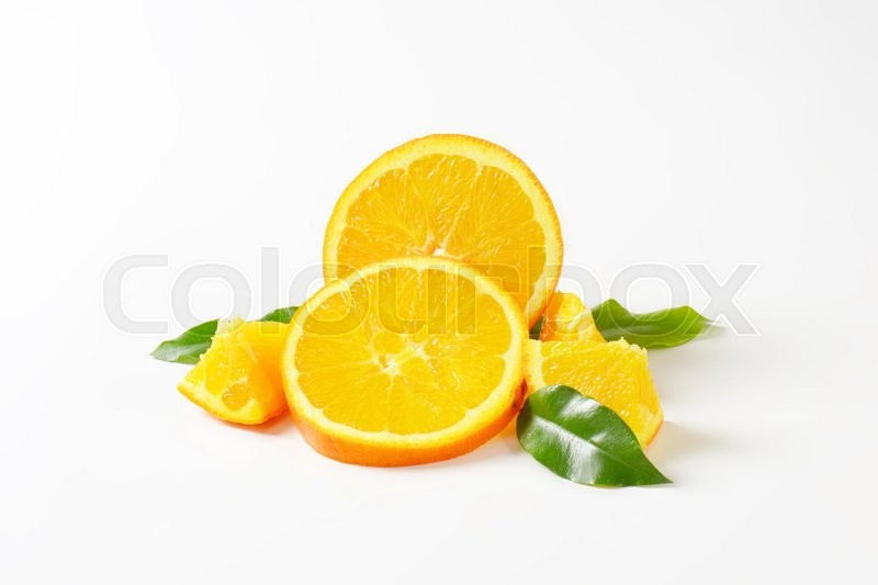 Stock image of 'Fresh orange slices on white background'