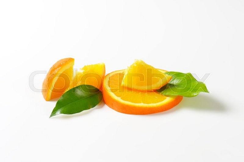Stock image of 'Pieces of fresh orange on white background'