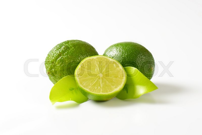 Stock image of 'Lime fruits, in cross section and whole'