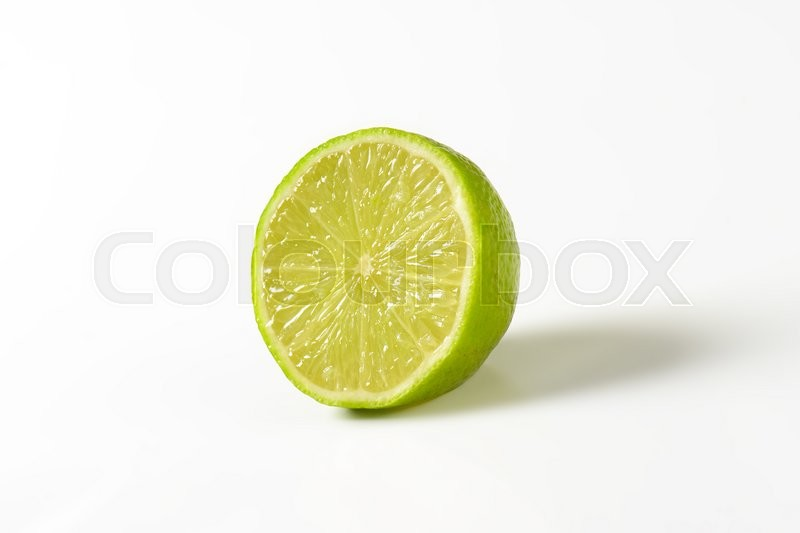 Stock image of 'Half a lime fruit on  white background'