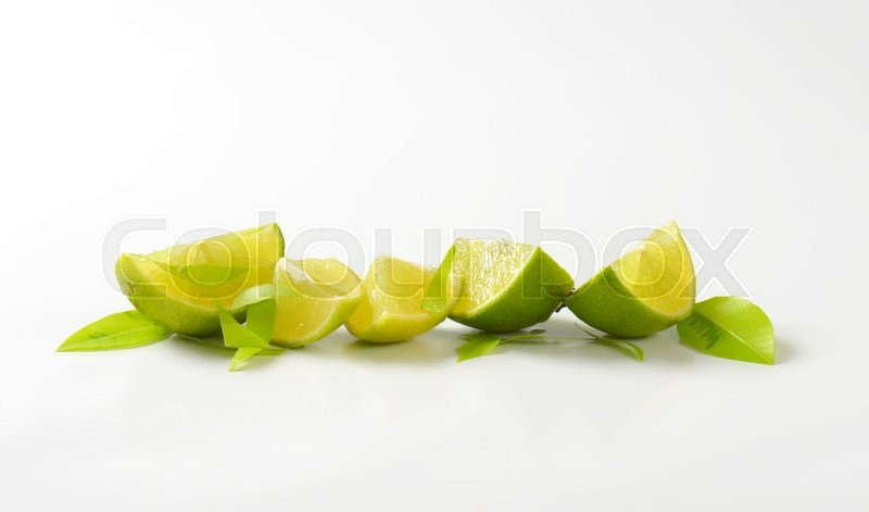 Stock image of 'Fresh lime wedges in a row'
