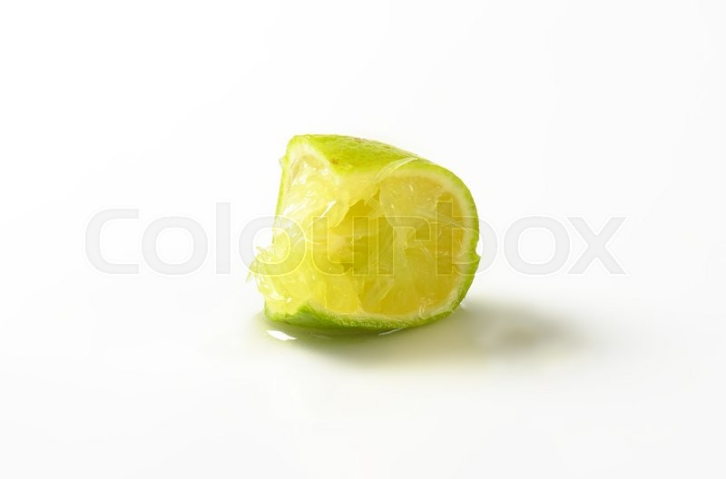 Stock image of 'squeezed slice of lime on white background'