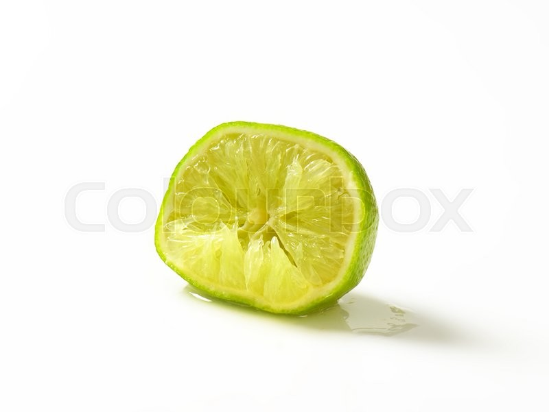 Stock image of 'Half a lime fruit - squeezed'