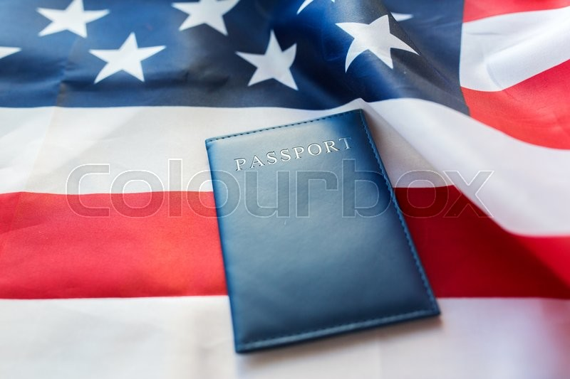 Stock image of 'citizenship, patriotism and nationalism concept - close up of american flag and passport'