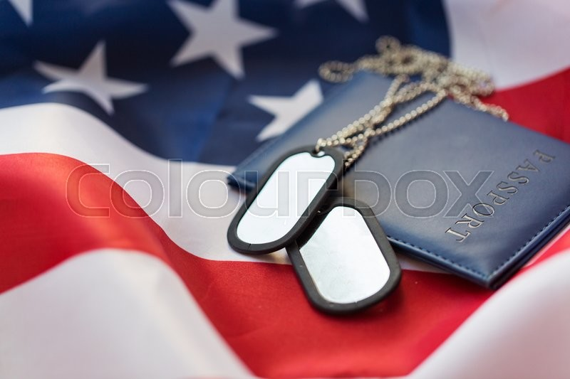 Stock image of 'military forces, patriotism, recruitment and national service concept - close up of american flag, passport and military badge'