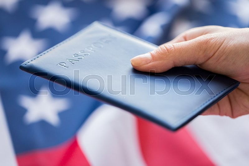 Stock image of 'citizenship, patriotism and nationalism concept - close up of hand with american passport'