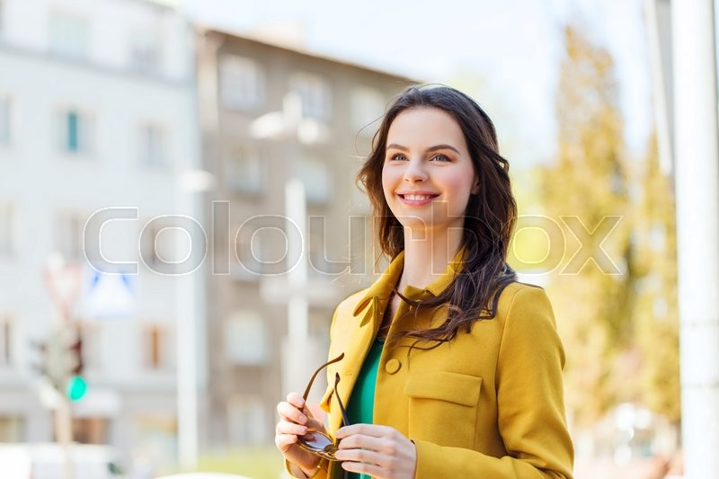 Stock image of 'summer, leisure, vacation and people concept - smiling young woman in city'