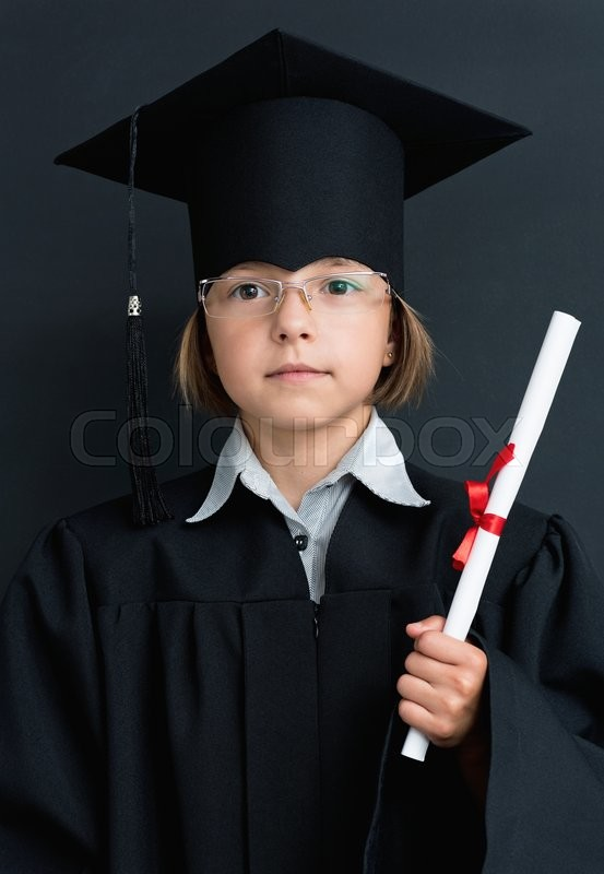 Stock image of 'Smart schoolgirl in glasses and academic hat stands with diploma at the blackboard'