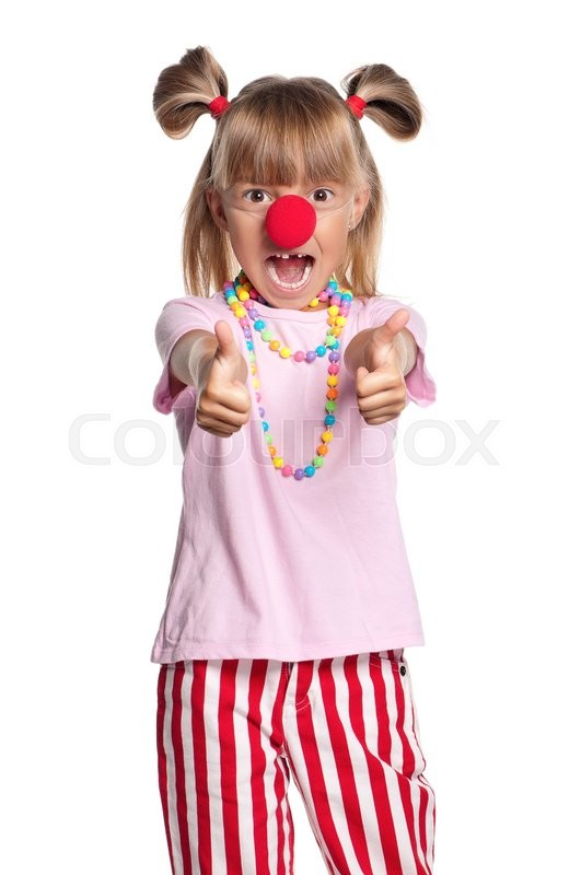 Stock image of 'Little girl with clown nose showing thumbs up gesture, isolated on white background'