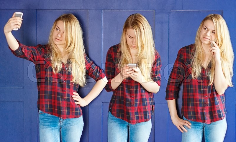 Stock image of 'Girl in a red shirt talking on the phone and typing a message and makes selfie near the blue wall. Triptych'