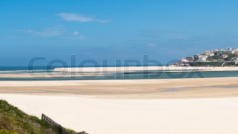 Editorial image of 'OBIDOS, PORTUGAL - JUNE 5 2016: Foz do Arelho beach at Obidos, Portugal is a popular tourist destination.'