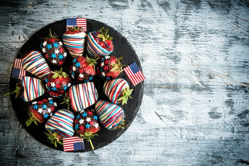 Stock image of 'Strawberries in chocolate with USA fleg decoration,4th of July concept,empty space '