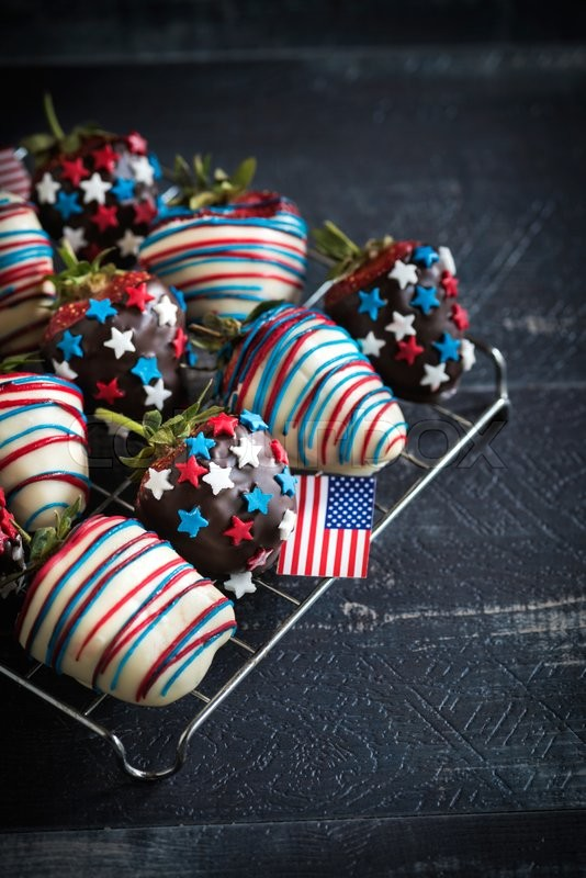 Stock image of 'Strawberries with USA flag decoration on wooden background,selective focus '