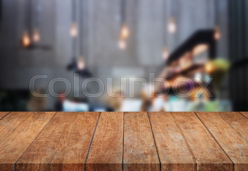 Stock image of 'Perspective table top wooden with blurred background. product display template'