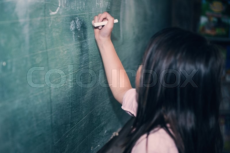 Stock image of 'a girl writing on blackboard'