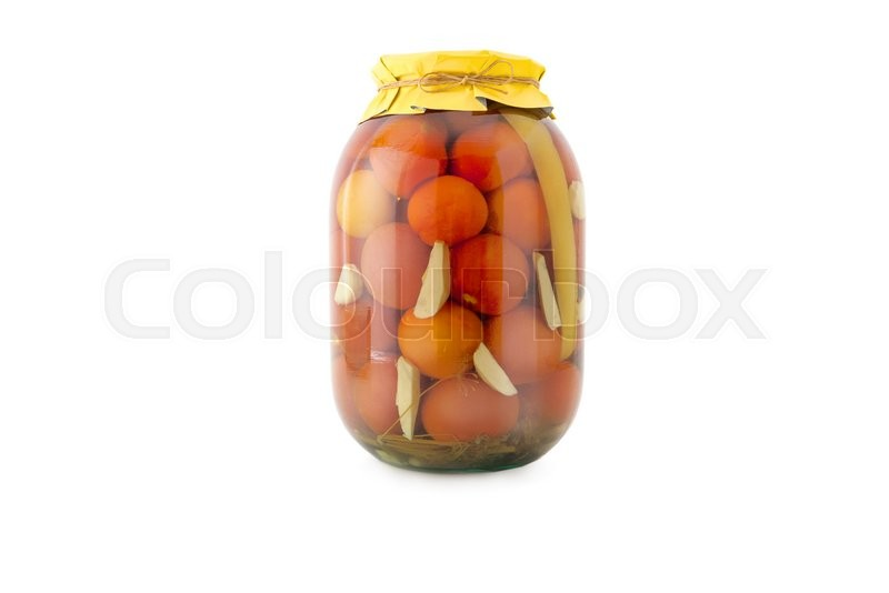 Stock image of 'Homemade pickled tomatoes in glass jar with yellow paper wrapper. Homemade preserves, pickles. Jar of canned marinated tomatoes isolated on white'