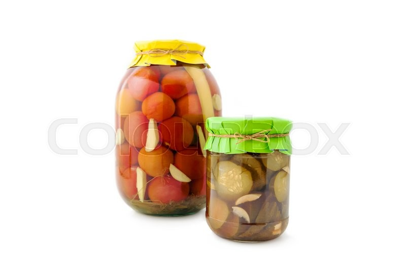 Stock image of 'Homemade pickled red tomatoes with cucumbers, garlic and pepperin glass jar with paper wrapper. Homemade preserves, pickles. Jar of canned marinated tomatoes and cucumbers isolated'